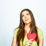 Dreaming woman hold heart . isolated portrait Stock Photos