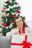 Dreaming woman holding big Christmas present box Royalty Free Stock Image
