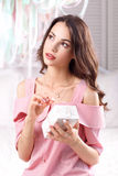 Dreaming woman opening gift box in bedroom. Gift Present Surprise Fun Joy Birthday Holiday Pleasure Sale Concept Stock Image