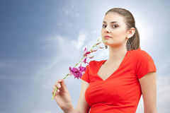Dreaming woman with orchid Stock Photography
