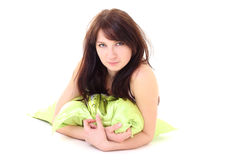 Dreaming woman in pajamas lying with green pillow Stock Image