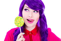 Dreaming woman with purple hair and colorful lollipop isolated o Stock Photography