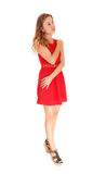 Dreaming woman in red dress. Royalty Free Stock Photography