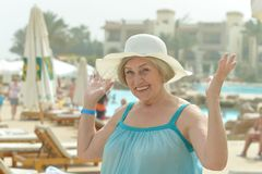Dreaming woman at the resort Royalty Free Stock Image