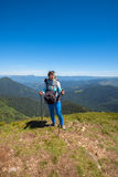 Dreaming woman, traveler with backpack relax on a top of mountai Stock Images