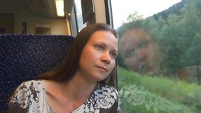 Dreaming woman traveling by train. Sadness. Pensive lonely woman travels by train thinking about farewell stock video