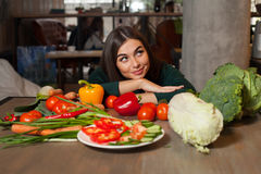 Dreaming woman and vegetables Stock Photo