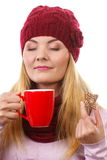 Dreaming woman in woolen cap and shawl with gingerbread cookies and tea, white background, christmas time Stock Photos
