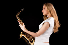 Dreaming young blonde with saxophone Royalty Free Stock Photography