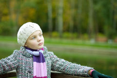 Dreaming Young Cute Girl In Modern Coat Stock Image