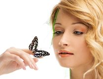 Dreaming young woman with butterfly Royalty Free Stock Photography