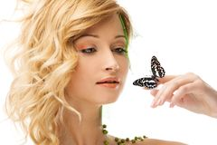 Dreaming young woman with butterfly Royalty Free Stock Photo