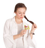 Dreaming young woman with green orchid Stock Images