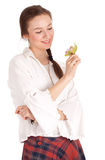 Dreaming young woman with green orchid Royalty Free Stock Photos