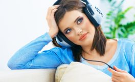 Dreaming young woman listening music. At home Royalty Free Stock Photos