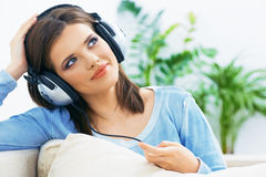 Dreaming young woman listening music Royalty Free Stock Image