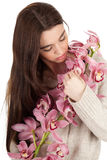 Dreaming young woman with orchid Royalty Free Stock Photos