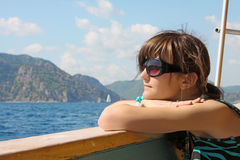 Dreaming young woman on yacht royalty free stock photography