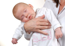 Dreamland. Baby sleeping on mami`s arm Stock Photography