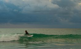 Surfer riding along the wave stock image