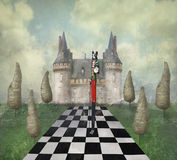 Dreamland. Fantasy surreal illustration in a dreamy place with a castle, trees, chess, sky, grass with a strange character stock illustration