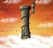 Dreamland tower. Beautiful medieval tower over the clouds Royalty Free Stock Photos
