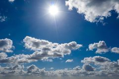 Dreamlike blue sky with white sheep clouds royalty free stock photography