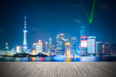 Dreamlike city background of shanghai skyline. At night , light show with wooden floor prospect Royalty Free Stock Photos