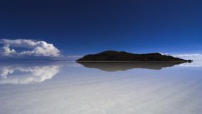 Dreamlike paradise island water reflection. Island (isla de los pescadores) in the salar de uyuni salt desert flats, a 12000 square km salt desert, at 3800m Royalty Free Stock Photography