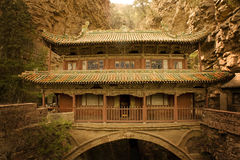 Dreamlike scenario of anient temple over a canyon. The complex of Cangyanshan, Hebei province, China. Fantastic ancient temple over a deep canyon Stock Photo
