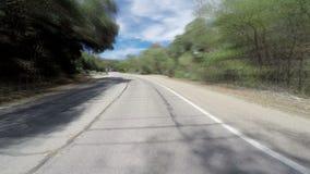 Dreamlike Time Lapse Driving POV. A surreal dreamlike time lapse driving down rural road stock video footage