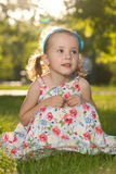 Dreamming girl in the park Stock Photos