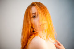 Dreammy fashion portrait of redhead woman in soft focus. In studio photo. Attractive and beautiful woman royalty free stock photo