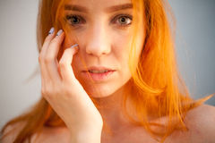 Dreammy gorgeous portrait of redhead woman in soft focus Stock Image
