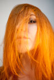 Dreammy portrait of attractive redhead woman in soft focus Royalty Free Stock Photos