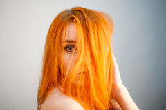 Dreammy portrait of bright redhead woman in soft focus Stock Photo