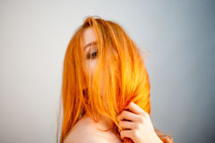 Dreammy portrait of bright redhead woman in soft focus Royalty Free Stock Photos