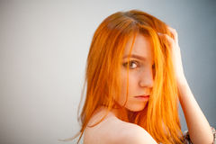 Dreammy portrait of fashion redhead woman in soft focus. In studio photo. Attractive and beautiful woman stock photo