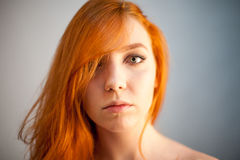Dreammy portrait of redhead woman in soft focus Royalty Free Stock Photos