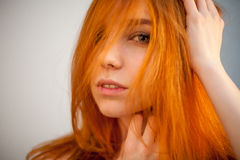 Dreammy portrait of shy redhead woman in soft focus Stock Photos