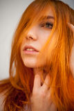 Dreammy portrait of shy redhead woman in soft focus Royalty Free Stock Photo