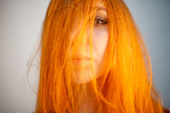 Dreammy portrait of shy redhead woman in soft focus Royalty Free Stock Image