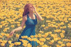 Dreammy woman in flower field Royalty Free Stock Images