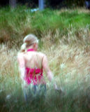 Dreams. A girl in the grass. Blurry shot Stock Photography