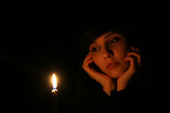 Dreams. The girl with a candle royalty free stock photos
