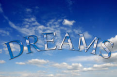 Dreams. Text with clouds texture against a sky background
