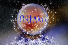 Dreams. A crystal ball in space holds the word dreams.  Concept for planning and dreaming of the future Stock Image