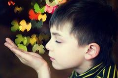 Dreams. Boy and creative bokeh of christmas tree lights royalty free stock image