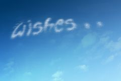Dreams. Clouds form the word wishes Stock Photos