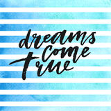 Dreams come true hand drawn lettering on blue watercolor stripes. Royalty Free Stock Photo
